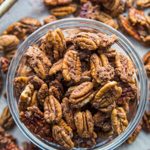 Top view of easy roasted pecans in a clear bowl