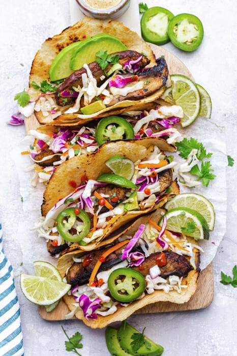 Top view of 4 mushroom tacos on parchment paper