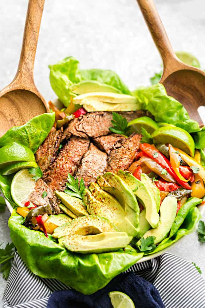 Easy Steak Fajitas are tender, juicy and full of flavor! Best of all, they come together super quick and are perfect for busy weeknights. Marinated in a homemade fajita spice blend and cilantro a delicious Tex-Mex cilantro lime marinade. Low carb and keto friendly serving options and great for meal prepping on Sunday for work or school lunchboxes or lunch bowls.