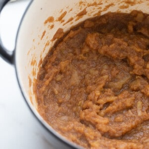 Top view of cooked apple butter in a blue pot