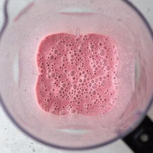 Blended strawberries and milk in a blender