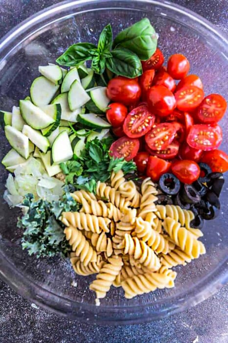 Top view of Summer Pasta Salad ingredients in a mixing bowl
