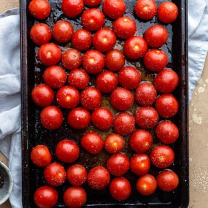 Top view of cherry tomatoes on a baking sheet