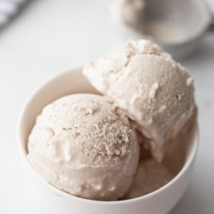 Top side side photo of vegan vanilla ice cream in a white bowl