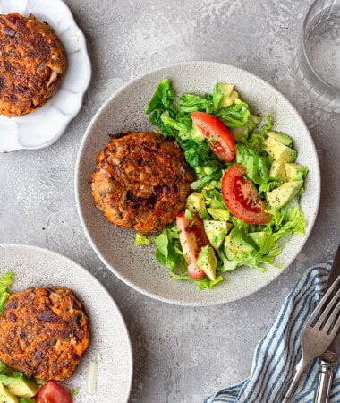 Top view of three veggie burger salads with a fork