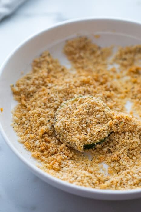 One zucchini coated with almond flour coating to make zucchini chips