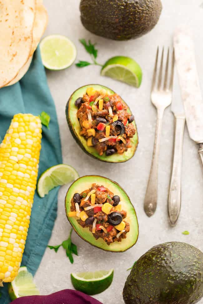 Enchilada Stuffed Avocado Cups have all the flavors you love about this popular Mexican dish. Perfect for lunch, dinner or as an appetizer at parties. Best of all, easy to customize turkey, chicken or beef plus low carb options included.