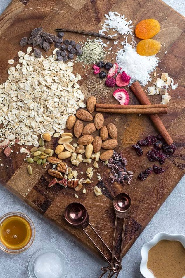 Ingredients to make energy balls on a wooden cutting board