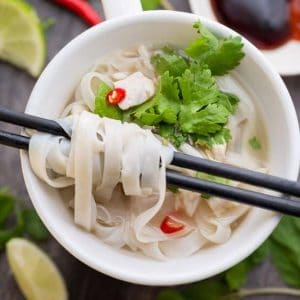 Top view of Faux Chicken Pho in a mug with chopsticks