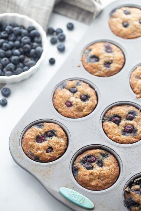 Side top view of blueberry muffins in muffin pan
