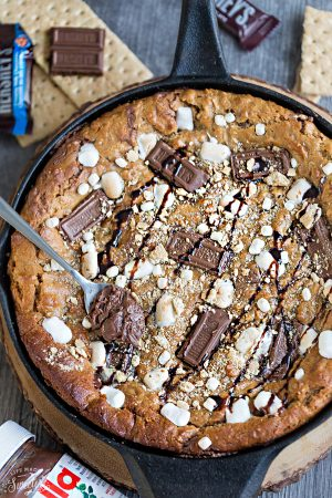 Flourless Nutella Stuffed S'mores Skillet Cookie makes the perfect easy decadent sweet treat for sharing at a party!