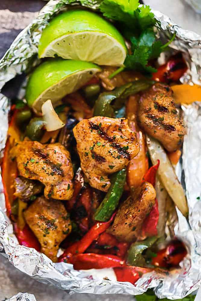 Chicken Fajita Foil Packets are the perfect easy meal for summer grilling and cookouts. Best of all, they're loaded with all your favorite Tex Mex flavors and make a low carb, paleo and keto friendly meal.