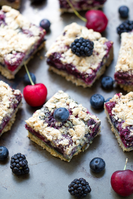 Overhead view of Fresh Cherry Berry Crumble Bars surrounded by berries and cherries