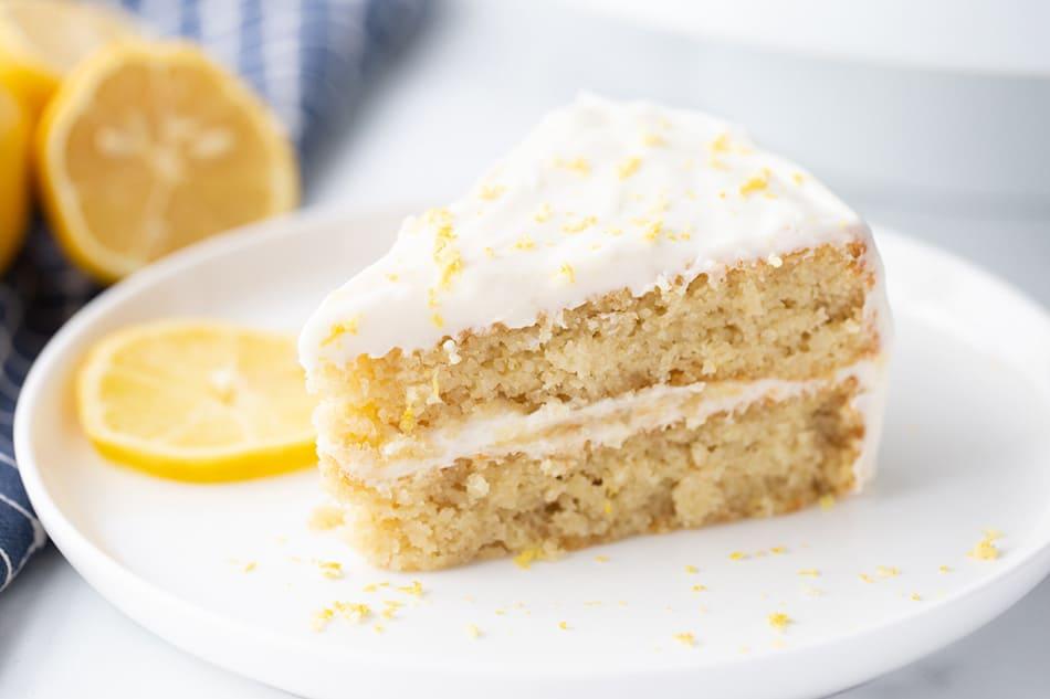 A slice of Lemon Cake on a white plate