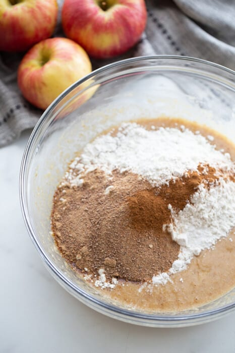 Top view of dry ingredients in a large mixing bowl for healthy apple muffins