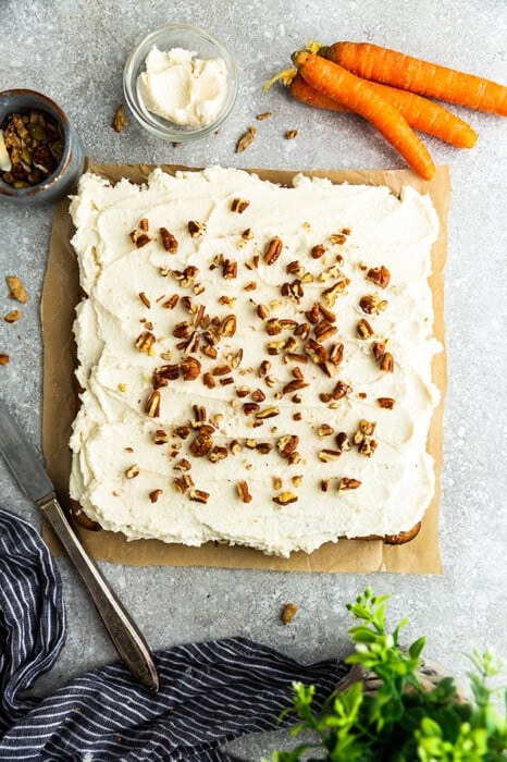 Top view of carrot cake squares on parchment paper