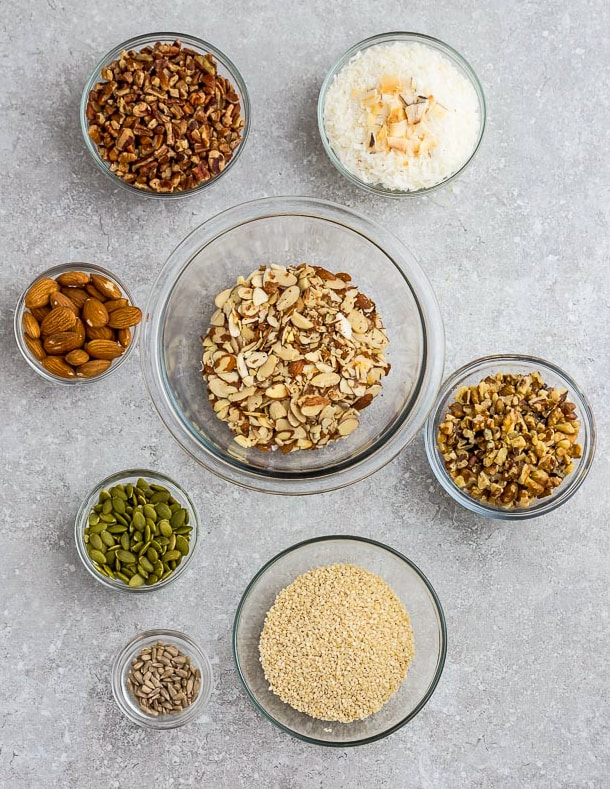 Top view of ingredients to make grain free gluten free granola on a grey background