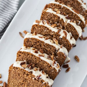 Top view of 7 slices of gluten free gingerbread loaf cake on a white plate