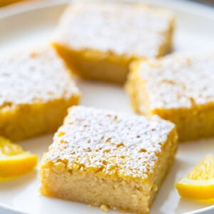 Side view of healthy lemon bars on a white plate