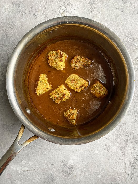 Crispy tofu in a pot of orange suace