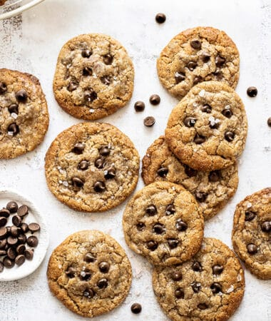 Top view of 10 paleo chocolate chip cookies on a white background