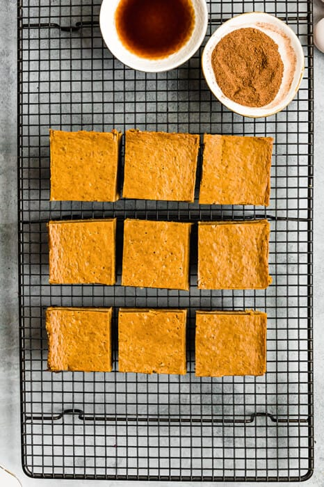 Top view of 9 healthy pumpkin bars son a black wire rack