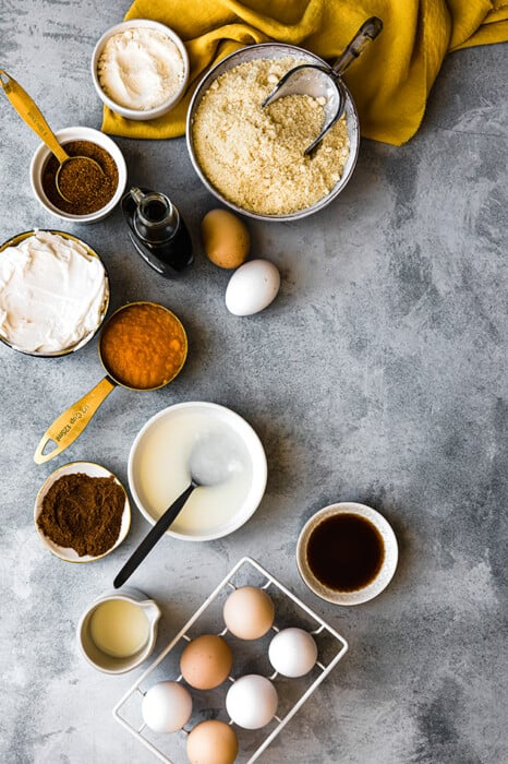 Top view of ingredients to make healthy pumpkin pie bars on a grey background
