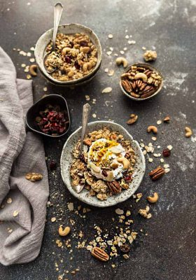 Coconut Cardamom Granola is the perfect easy grab and go breakfast or snack. Best of all, it's gluten free & full of crunchy clusters, nuts & warm spices.