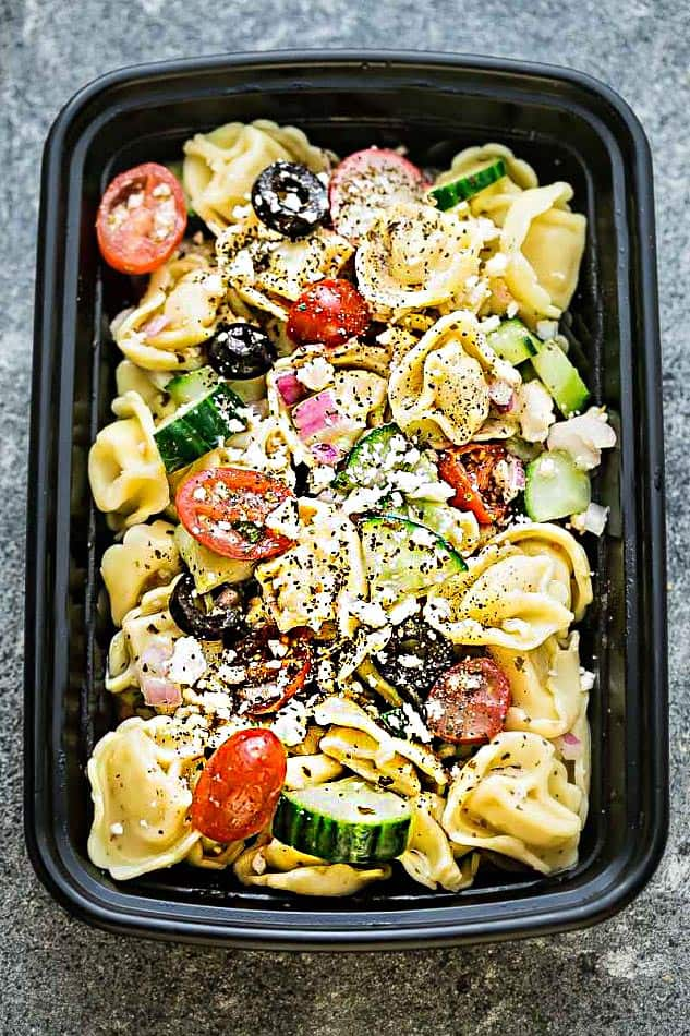 Top view of Greek Tortellini Pasta Salad in a meal prep container