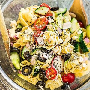 Top view of Greek Tortellini Pasta Salad in a glass bowl