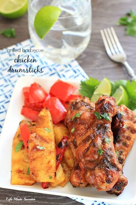 Grilled chicken drumsticks are basted with Kraft Sweet Honey Barbecue Sauce to create a delicious mild and sweet flavor along with grilled pineapples and bell peppers.