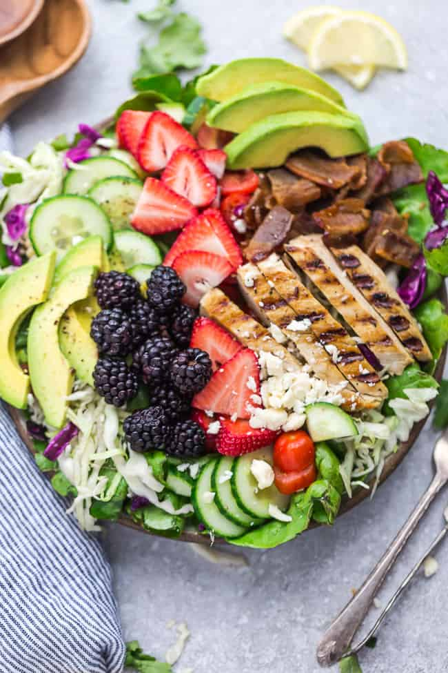 Summer Berry Grilled Chicken Salad - an easy and healthy lunch or dinner perfect for busy weeknights or summer potlucks. Made with avocado, cucumber, bacon, strawberries, blackberries and tomatoes with a tangy, fresh and flavorful lemon vinaigrette.