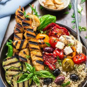 Top view of a Grilled Greek Chicken Souvlaki Quinoa Brown Rice Bowl