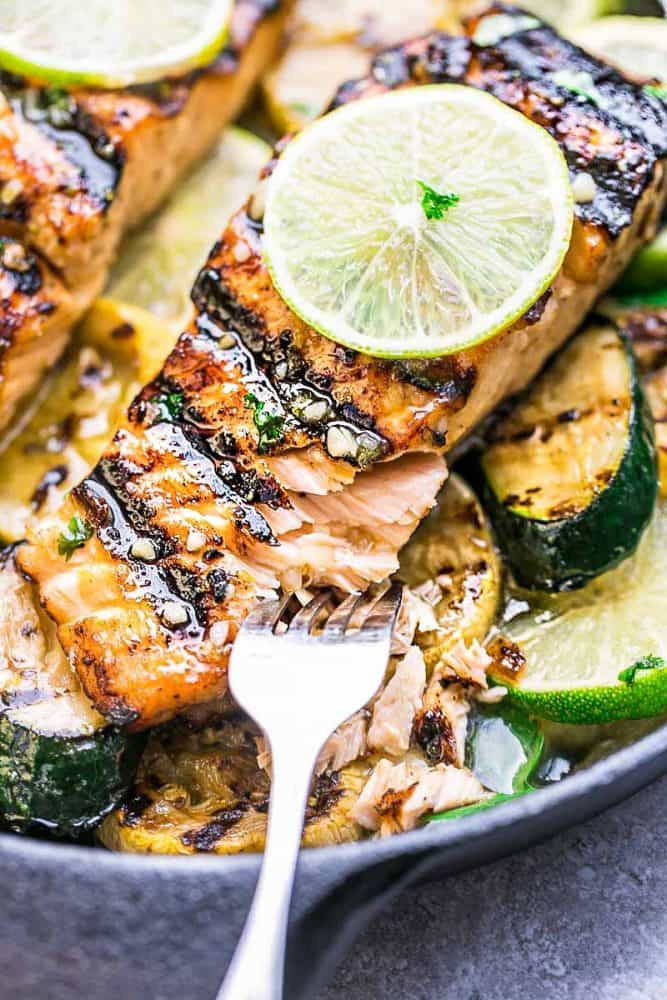 is a light and tasty dish that is just perfect for summer and busy weeknights. Best of all, the honey and lime butter sauce is sweet, tangy and so amazingly flavorful and the salmon gets cooked to tender flaky perfection every time! Clean up is a breeze if you want to cook it on a piece of foil or leave on the grill for those pretty grill marks!
