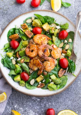 Grilled Shrimp Avocado Salad - a light and healthy & flavorful dish perfect for lunch or a light dinner. Made with spinach, avocado, cherry tomatoes, pecans, almonds and a homemade poppy-seed dressing. Low Carb, keto, paleo & Whole 30 compliant.