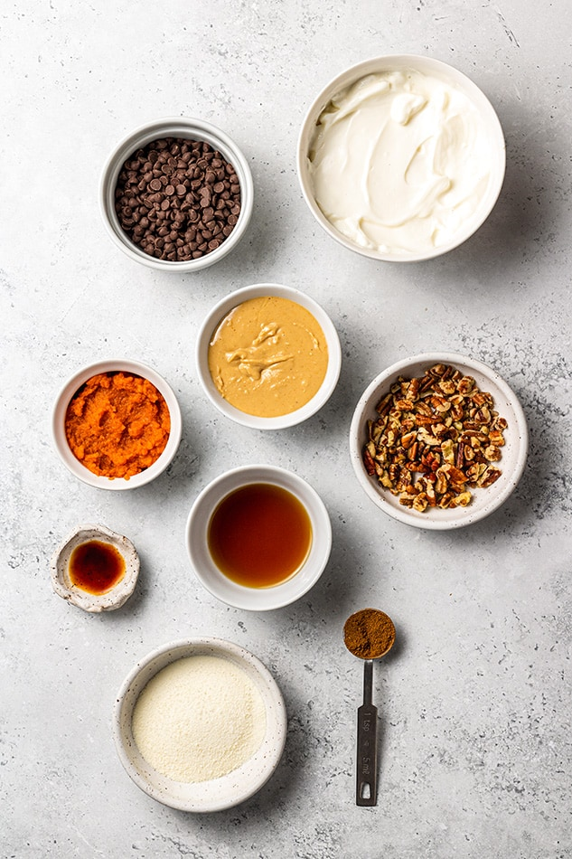 Overhead view of ingredients for pumpkin dip in individual bowls