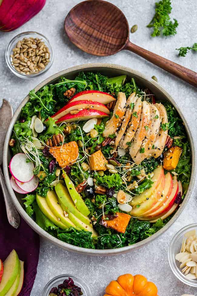 Harvest Fall Salad is full of hearty autumn vegetables, in season fruit with a simple apple cider vinaigrette. Made with kale, endive, chicken, crispy apples, pears, roasted pumpkin, cranberries and crunchy pecans. Best of all, with low carb, keto, paleo & whole 30 options.