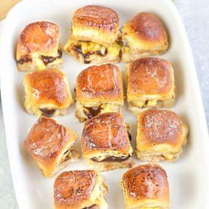 11 BBQ Chicken Sliders in a white casserole pan