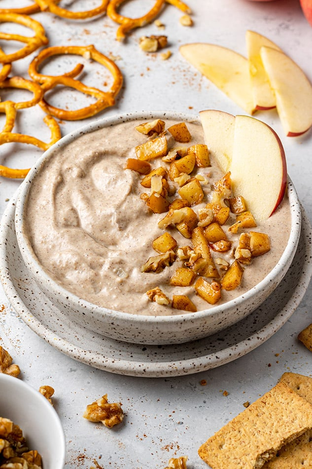 A bowl of Apple dip with diced apples and nuts