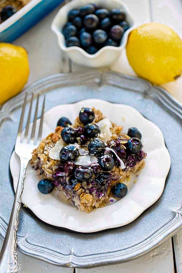 A Piece of Blueberry Oatmeal Casserole on a White Plate with a Fancy Fork