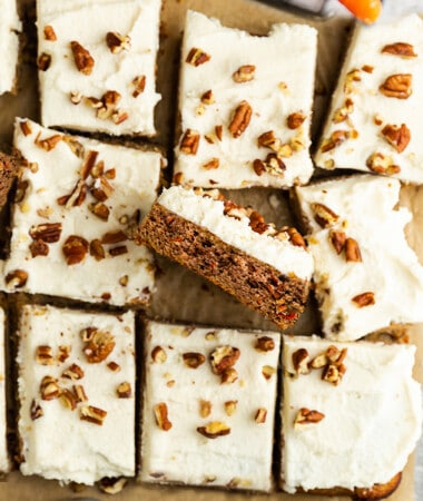 Top view of carrot cake bars on parchment paper