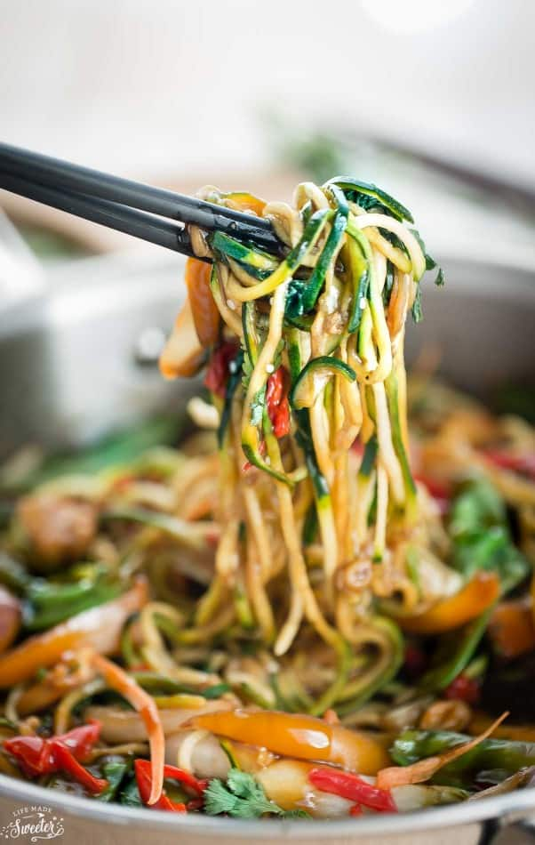 chopsticks holding some healthy chicken chow mein zoodles (zucchini noodles)