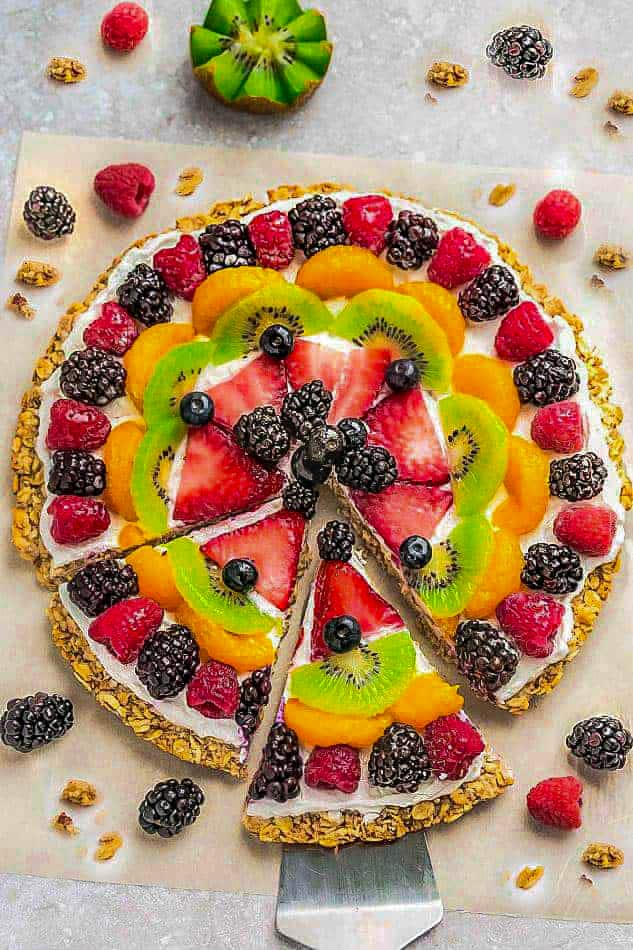 Top view of Healthy Fruit Pizza on parchment paper