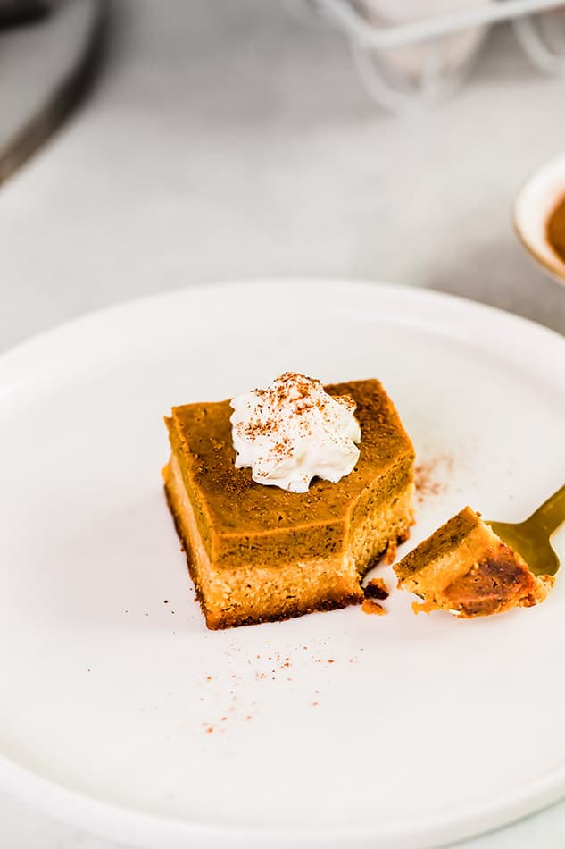 Top view of healthy pumpkin bar on a white plate with a fork