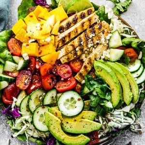 Close-up view of mango chicken salad in a bowl