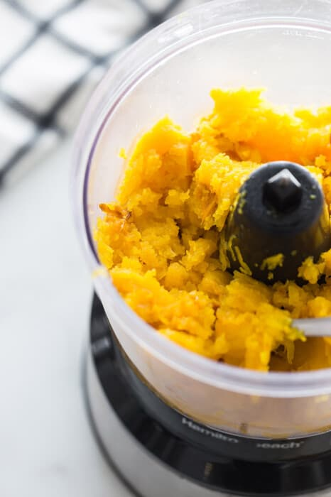 Cooked pumpkin in a food processor bowl