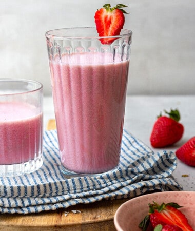 Side view of one strawberry milkshake in a glass