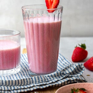 Side view of one strawberry smoothie in a glass