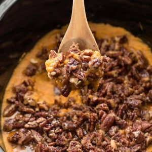 Pecan-topped sweet potato casserole in a slow cooker
