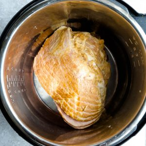 Top view of uncooked instant Pot Ham in a pressure cooker